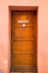 Old Wood Door in Pink Stucco Building