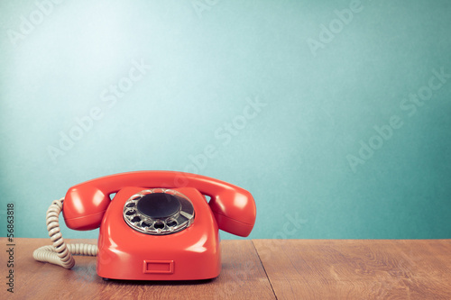 Retro red telephone on wood table near aquamarine background - 56863818