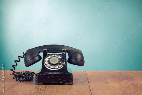 canvas print picture Retro telephone on table in front mint green background