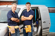 Leinwanddruck Bild - Workers In Family Business Standing Next To Van