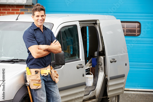 Plumber Or Electrician Standing Next To Van