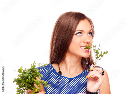 Housewife bites parsley