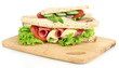 Tasty sandwiches with salami sausage and vegetables