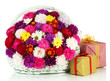 Beautiful bouquet of chrysanthemums in wicker basket isolated