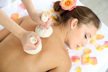 Beautiful young woman having back massage close up