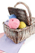 Multicolored clews in wicker basket with napkins closeup
