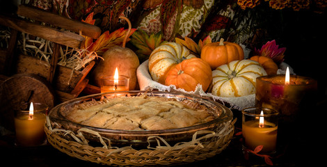 Pumpkins and cake on candle light still life