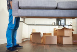 Close Up Of Man Carrying Sofa As He Moves Into New Home - 56868224