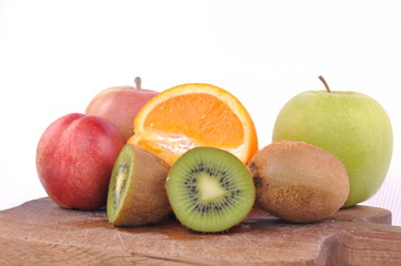 Fresh fruits on wooden plate isolated on white backgorund