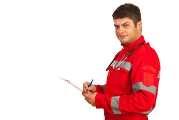 Paramedic taking notes