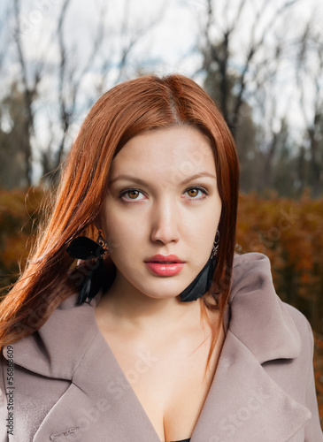 foxy-red haired women outdoors weared jacket at autumn time