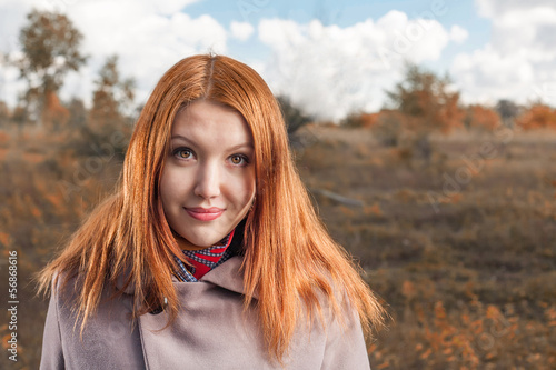 carrot-top women smiling at fall