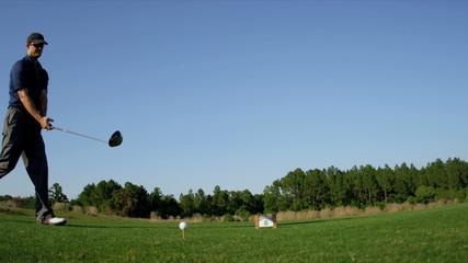 Golfer Preparing Driving Off Golf Resort Fairway