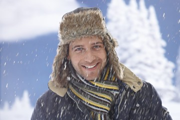 Winter portrait of happy man