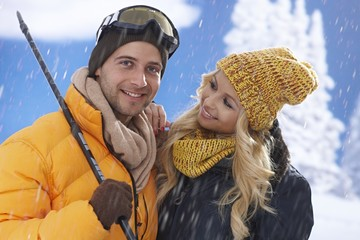 Portrait of happy loving couple at wintertime