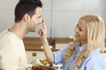 Loving couple having fun in kitchen