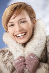 Laughing girl in fur coat