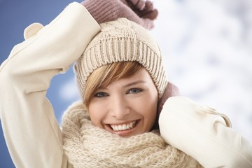 Portrait of happy young woman in warm coat