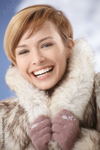Laughing girl in fur coat