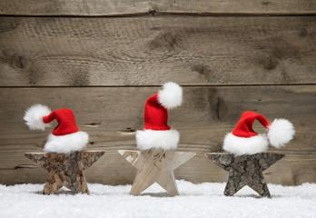 Weihnachtssterne aus Holz als Weihnachtskarte rustikal