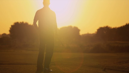 Male Golfer Sunset Silhouette Following Shot