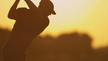 Male Caucasian Golfer Driving Off Fairway Sunset Silhouette