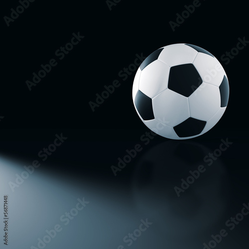 Soccer ball on elegant black scene.