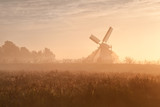 Dutch windmill in fog and morning sunshine