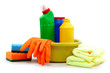 Detergent bottles, rubber gloves and cleaning sponge on a white