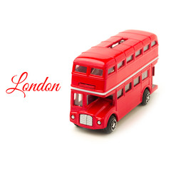 London bus money box toy isolated on white background