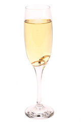 Glass of champagne with wedding rings