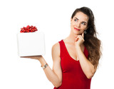 Woman holding gift and thinking