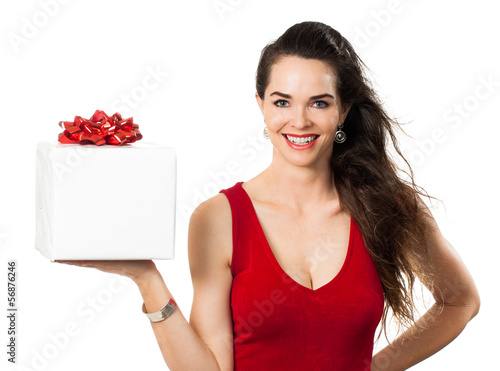 A happy woman holding a gift