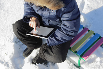 boy outdoors with tablet PC