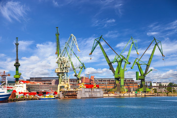 Big cranes and dock at the shipyard of Gdansk, Poland.