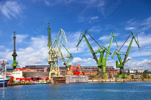 Zdjęcia na płótnie, fototapety na wymiar, obrazy na ścianę : Big cranes and dock at the shipyard of Gdansk, Poland.