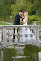 Bride and groom in a park outdoor - Married couple