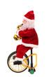 Leinwandbild Motiv Santa Claus doll on a bike.