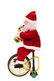 Santa Claus doll on a bike.