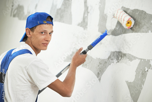 painter at home renovation work with prime - 56878048