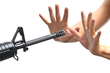 a rifle pointing to empty hands