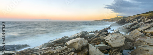 Panorama of ocean shore at a crack of dawn (Slow shutter speed)