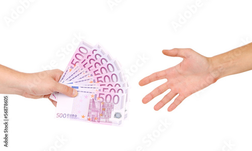 Male hand giving money to a man.