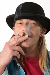 man with bowler hat is smoking
