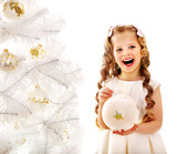 Child decorate white Christmas tree.