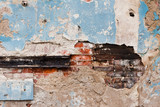 Old crumbling plastered brick wall