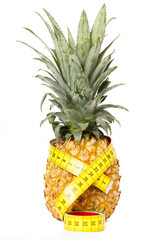 Pineapple with measuring tape