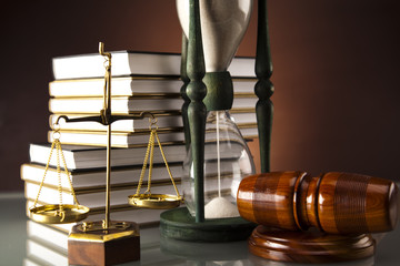 Golden scales of justice, gavel and books ,coins,Legal hourglass