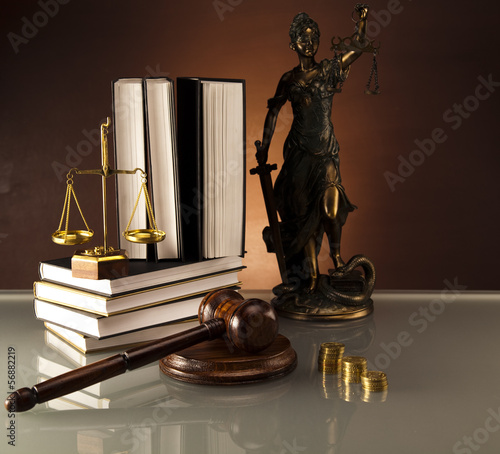 Statue of Lady Justice, gavel and books,coins