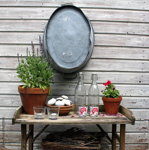 Garden table against a wooden fence